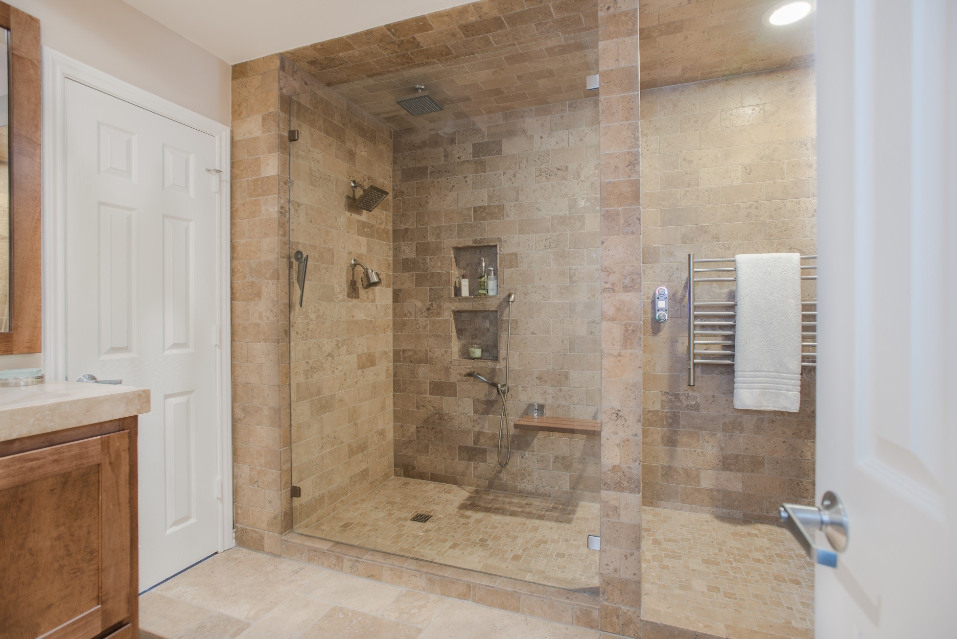 The End Result Is A Spacious Shower With Shampoo Inserts, Multiple Shower  Heads With A Water Pressure An Temperature Control, A Teak Seat And Towel  Warmer ...